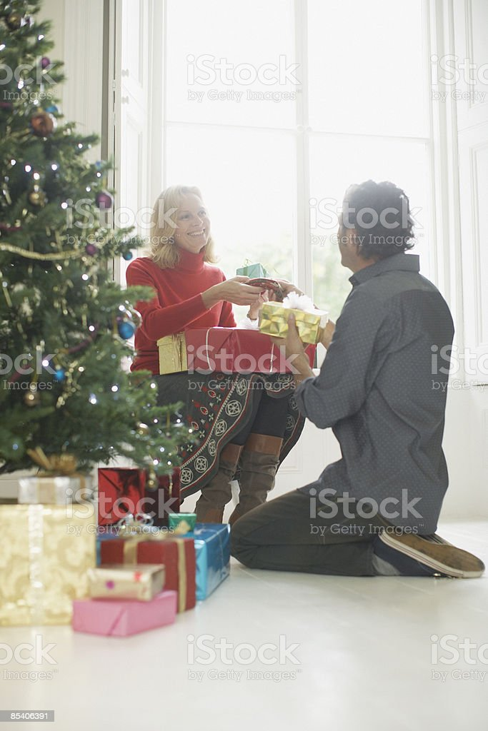 Couple exchanging Christmas gifts royalty-free stock photo