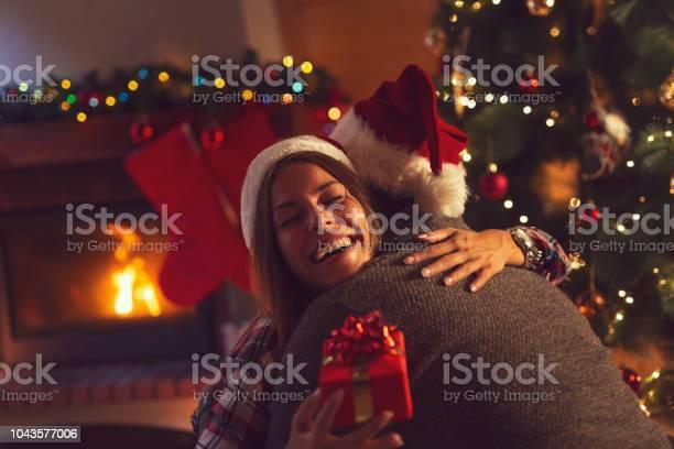 Couple exchanging christmas presents picture id1043577006?b=1&k=6&m=1043577006&s=612x612&h=rxatbjlx7g6kxcdripxhalafciafzdasf8vmisvuogq=