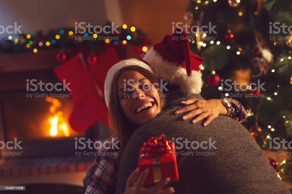 Couple exchanging Christmas presents stock photo
