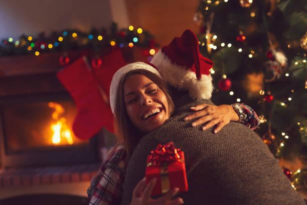 Couple exchanging Christmas presents stock photo