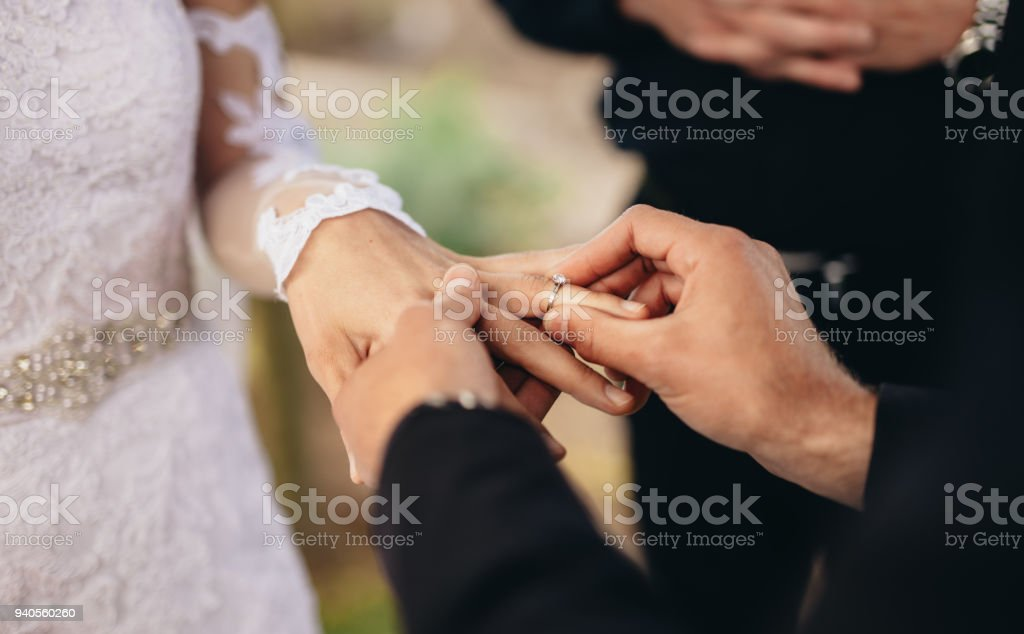 Couple exchanging wedding rings stock photo