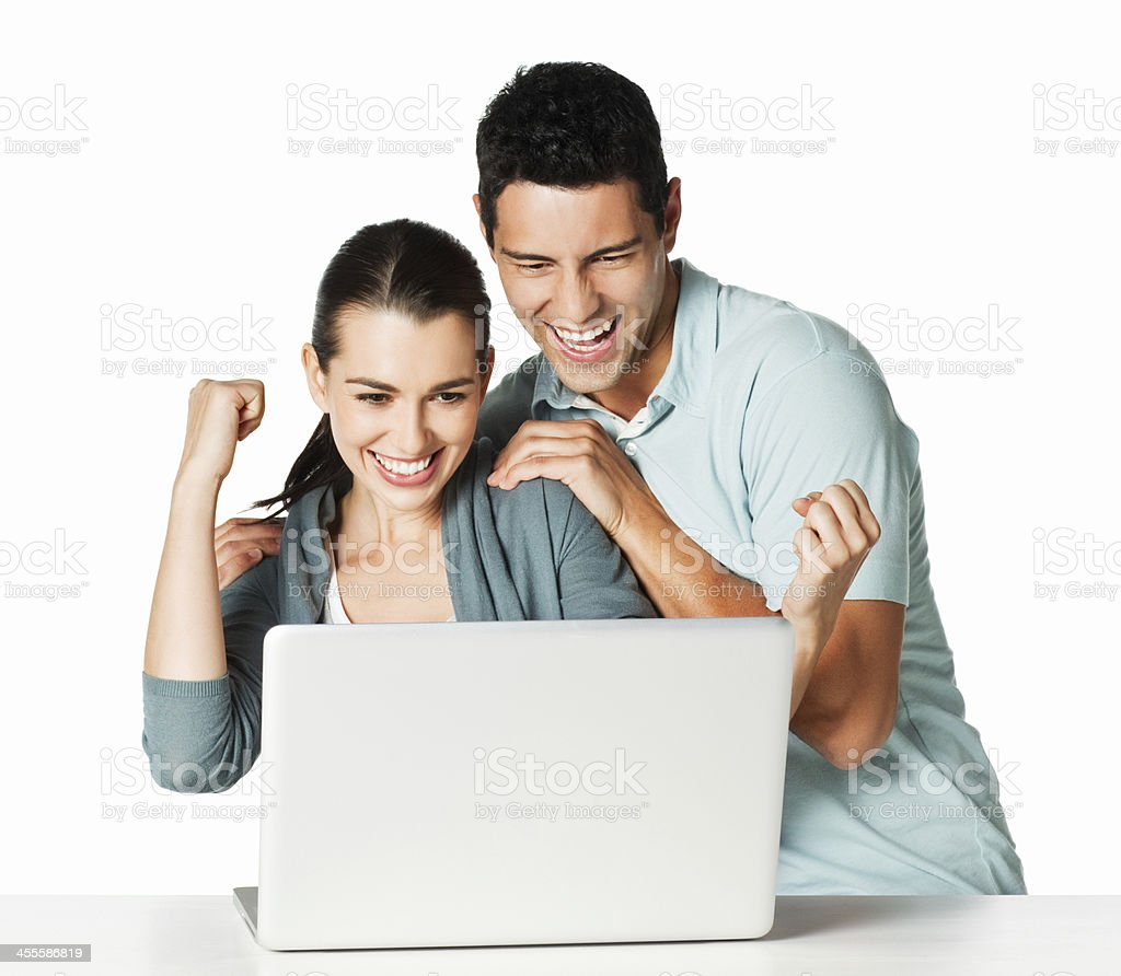 Couple Excited at the Computer - Isolated royalty-free stock photo