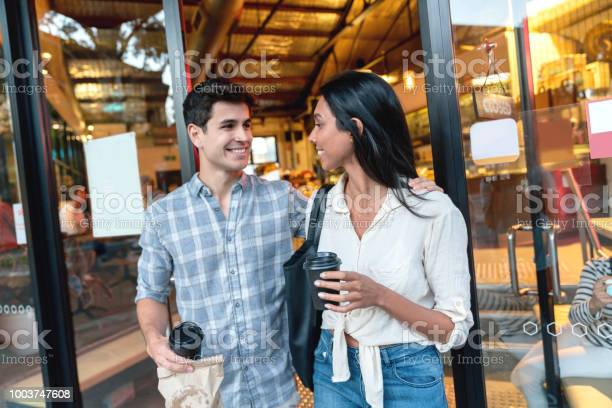 Couple exiting a cafe carrying coffee to go picture id1003747608?b=1&k=6&m=1003747608&s=612x612&h=ldmbpggk az1pravdfu3mc oci2dz 3xb2fnemzgyma=
