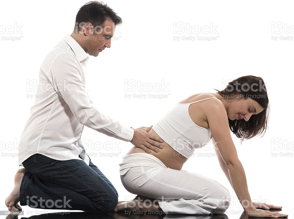 Couple Expecting Baby pregnant woman back Massage stock photo