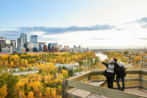 A couple overlooking the city of Calgary, Canada