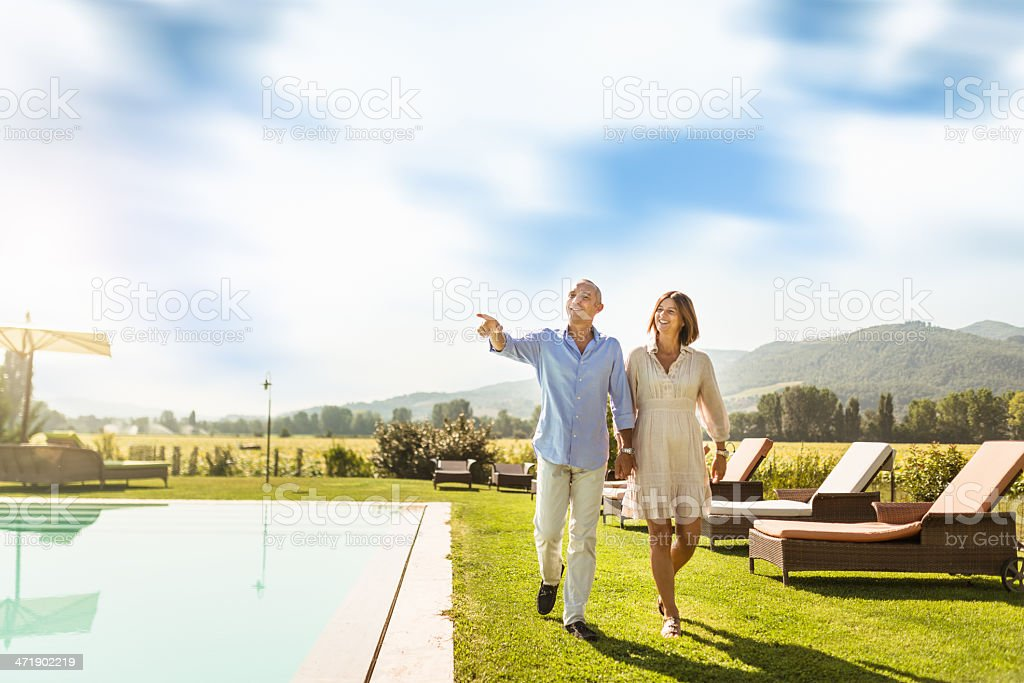 couple exploring the resort on vacation stock photo