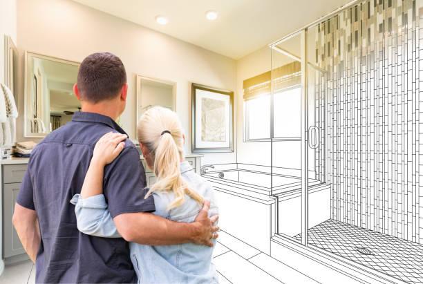 pares que enfrentam o desenho do banheiro que gradating à foto - banheiro doméstico - fotografias e filmes do acervo