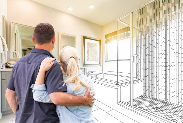 couple facing bathroom drawing gradating to photo - bathroom renovation stock photos and pictures