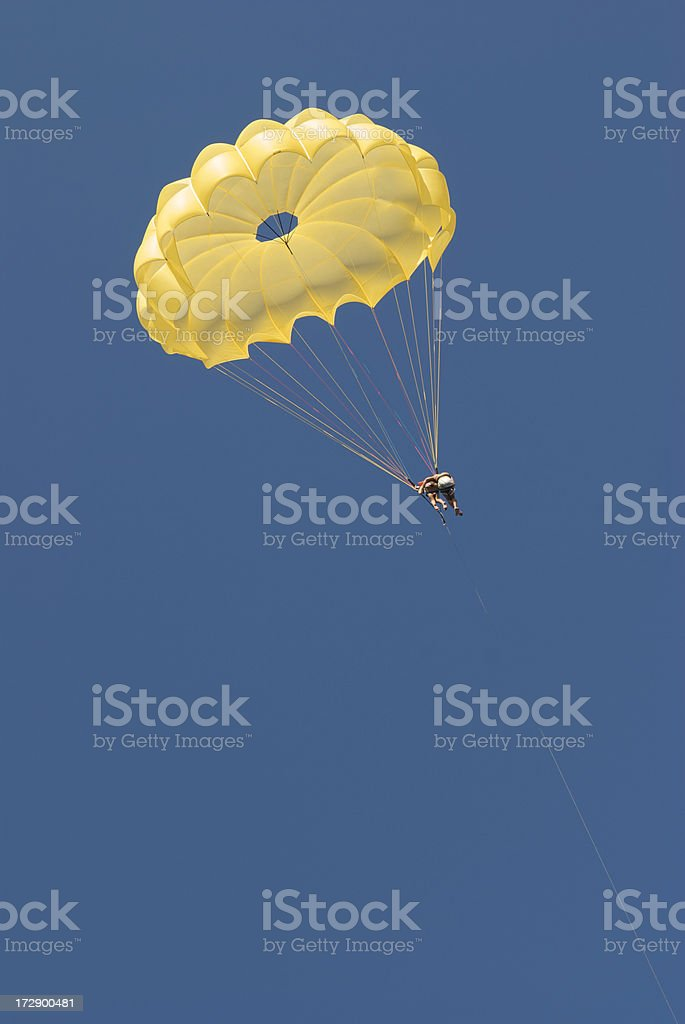 Couple Falling in Love Yellow Parachute Blue Sky royalty-free stock photo