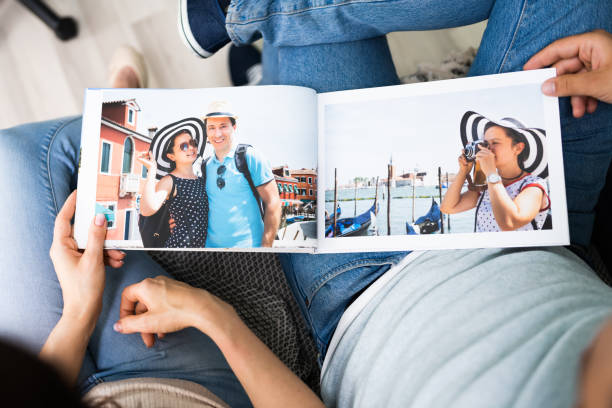 Couple Family Looking Photo Album stock photo