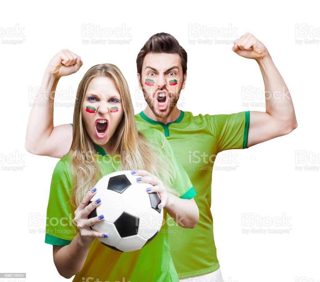 Casal ventilador / Sport Player uniforme verde comemorando - foto de acervo