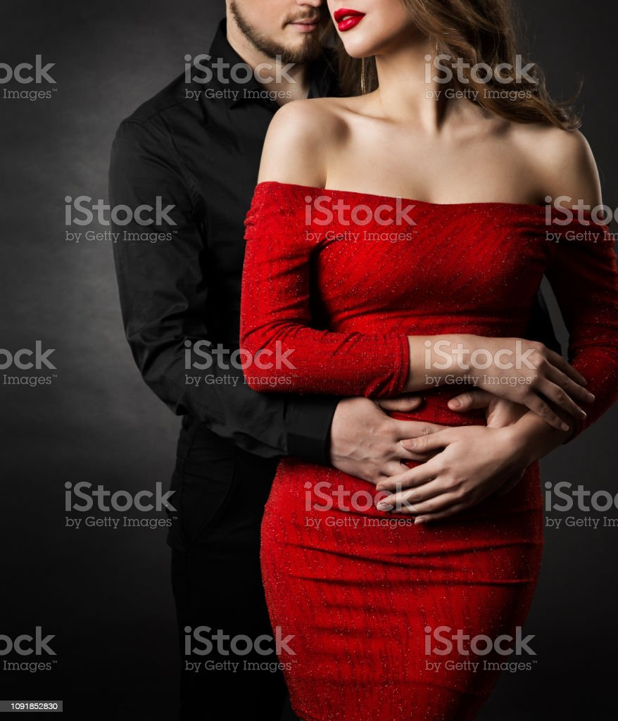 Couple Fashion Beauty, Woman in Red Dress and Embracing Man in Love royalty-free stock photo