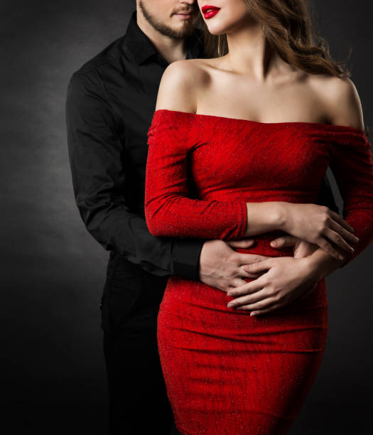 couple-fashion-beauty-woman-in-red-dress-and-embracing-man-in-love-picture-id1091852830?k=6&m=1091852830&s=612x612&w=0&h=AAA672AURjeBHQiWUxLSfFDMGPp5QeGpFx2gtm4gJEo=