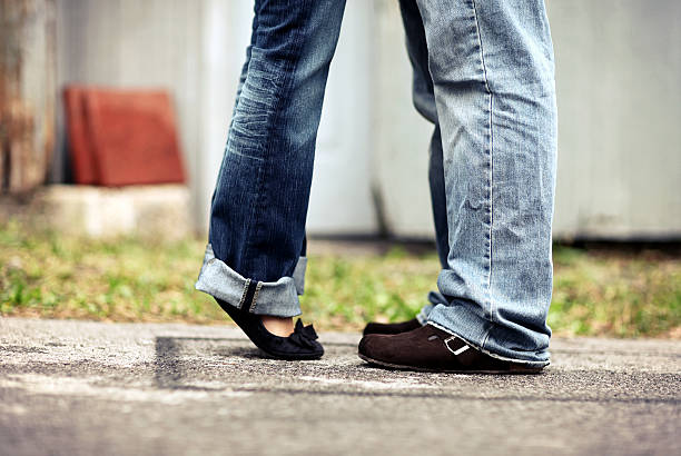 Couple Feet Love couple feet in love. skinny jeans stock pictures, royalty-free photos & images