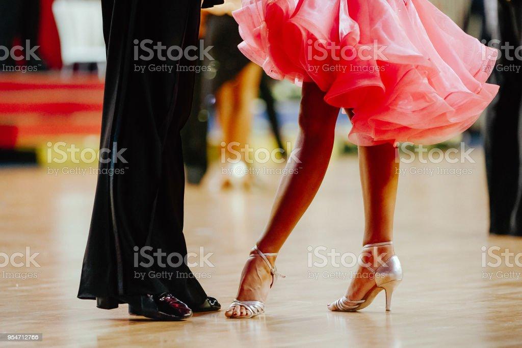 couple feet of dancers, woman and man latino dancing stock photo
