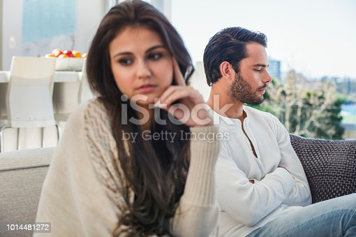 520496686istockphoto Couple fighting at home. 1014481272
