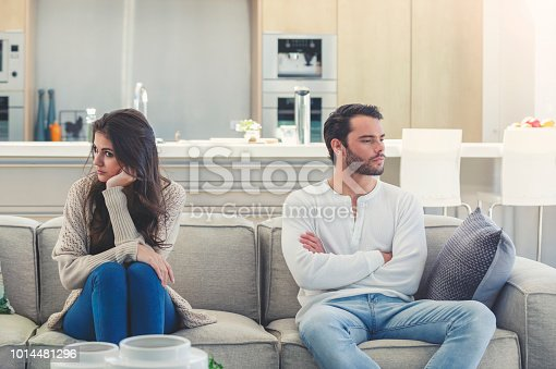 520496686istockphoto Couple fighting at home. 1014481296