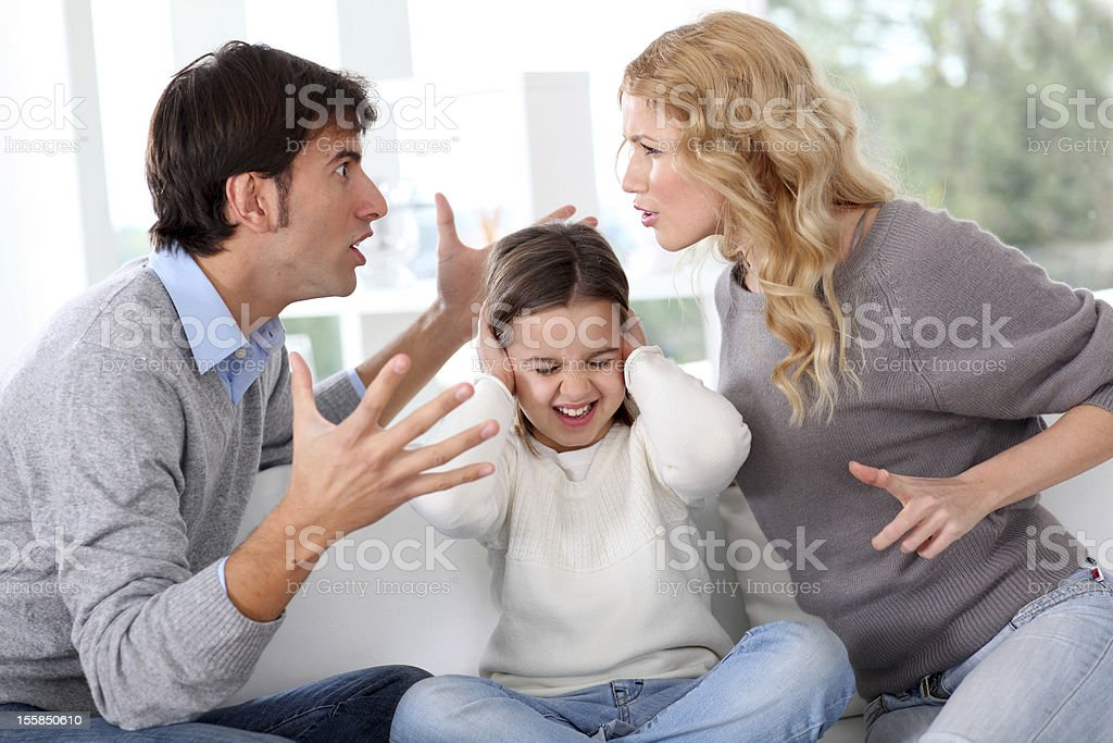 Couple fighting in front of child stock photo