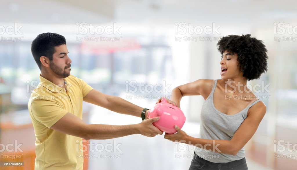 Couple fighting over money Couple fighting over money 20-29 Years Stock Photo