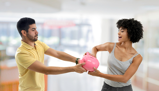 Couple Fighting Over Money Stock Photo - Download Image Now