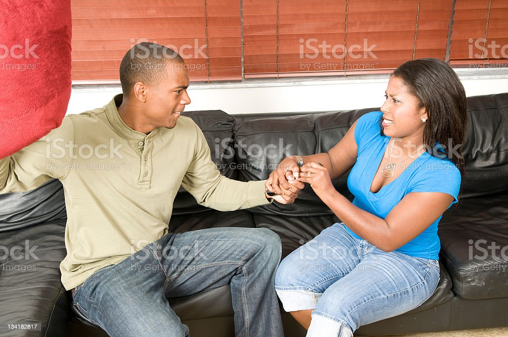 Couple Fighting over Remote stock photo