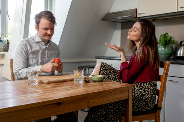 Couple flirting during breakfast before going to work stock photo