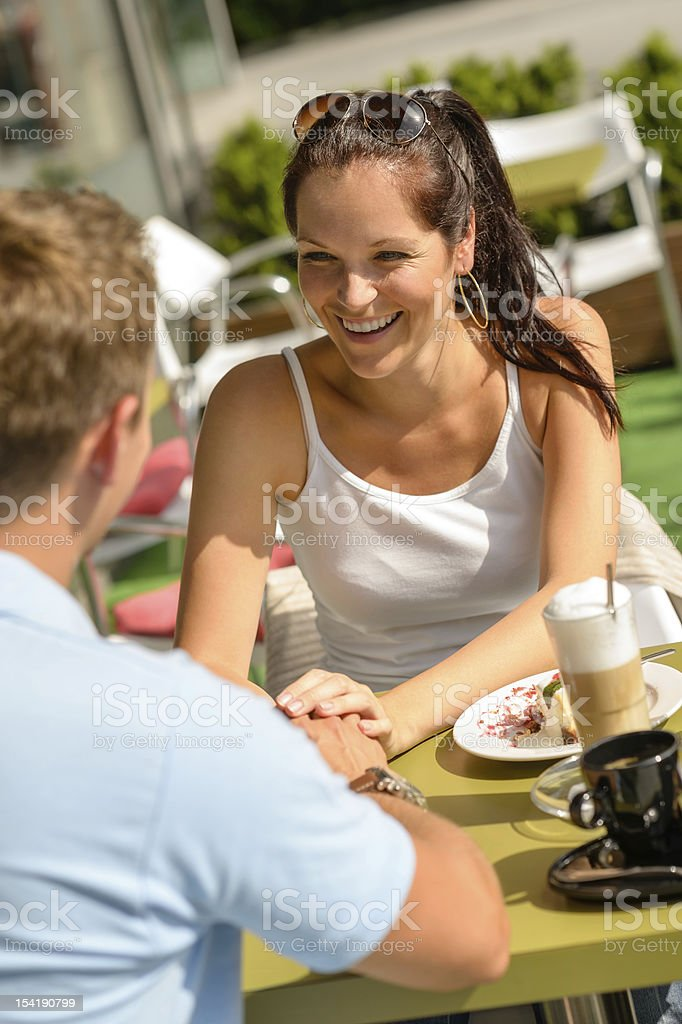 Couple flirting holding hands at cafe bar royalty-free stock photo