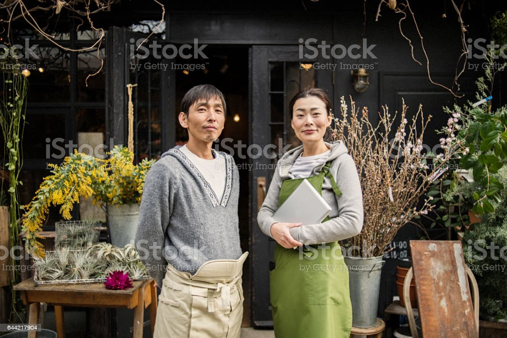 Couple florists working in flower shop stock photo