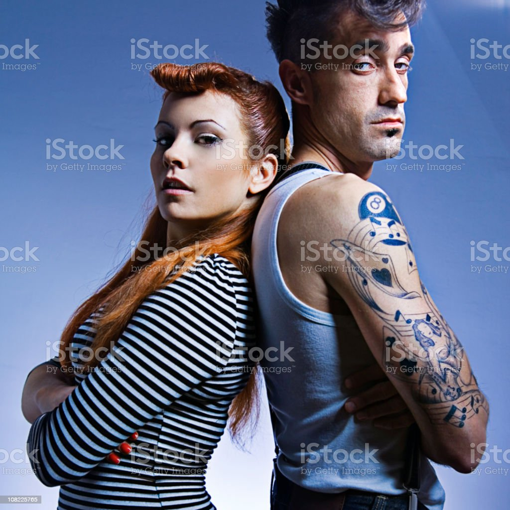 Couple Folding Arms and Leaning on Each Other's Back stock photo