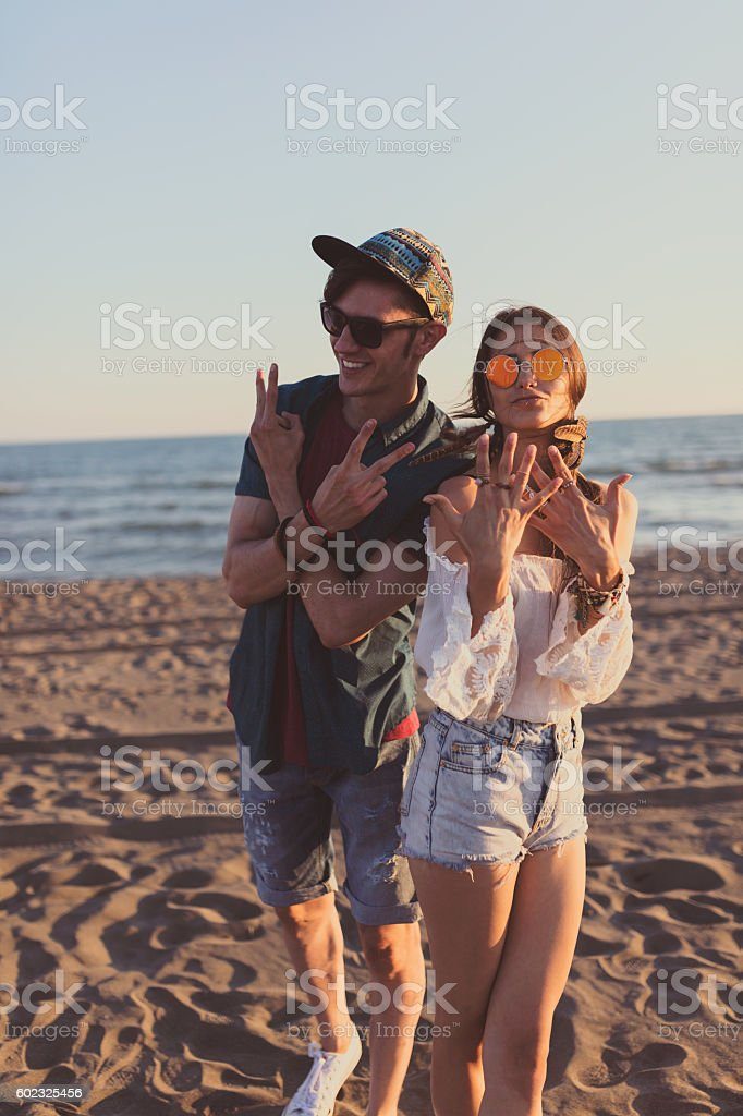 Couple fooling around on the beach stock photo