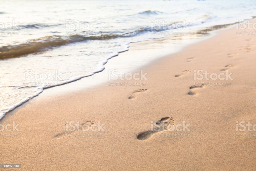 couple footprints on the beach stock photo