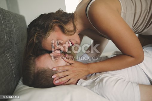 istock Couple foreplay in bed 620400064