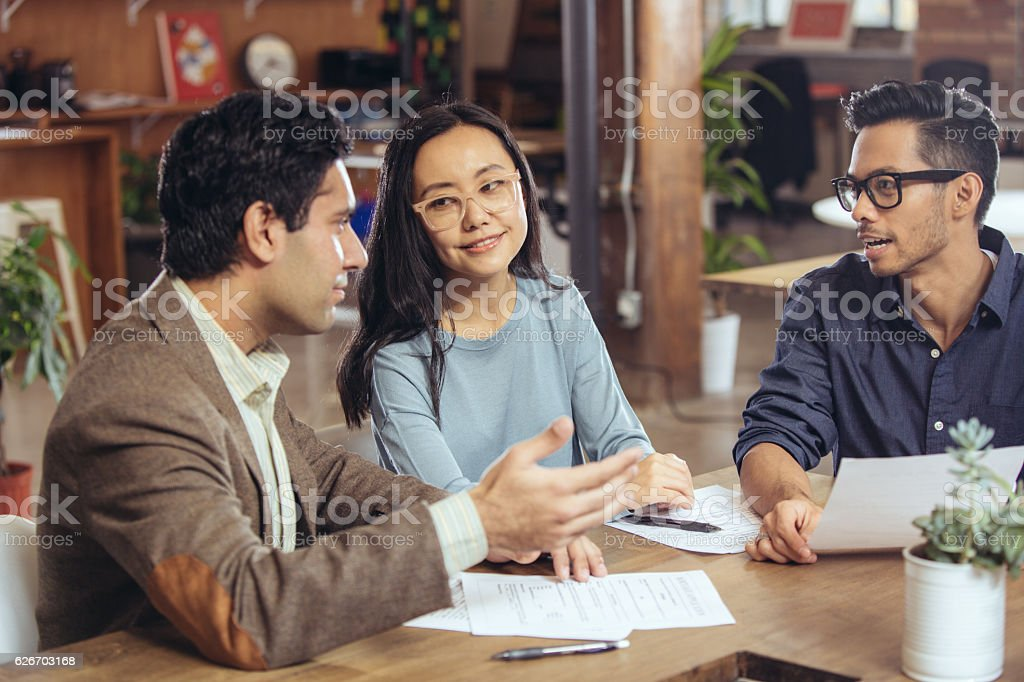 Couple getting financial advice stock photo