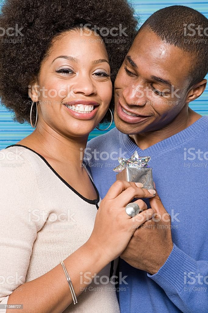 Couple giving presents royalty-free stock photo