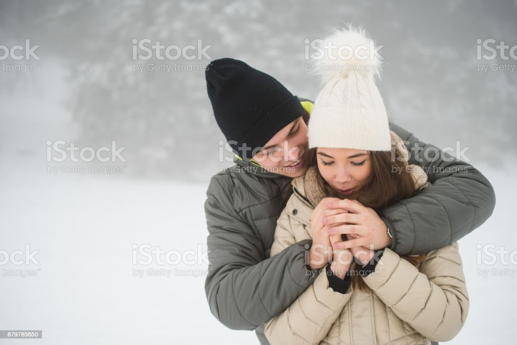 Couple going cold sheltered in winter outdoors stock photo