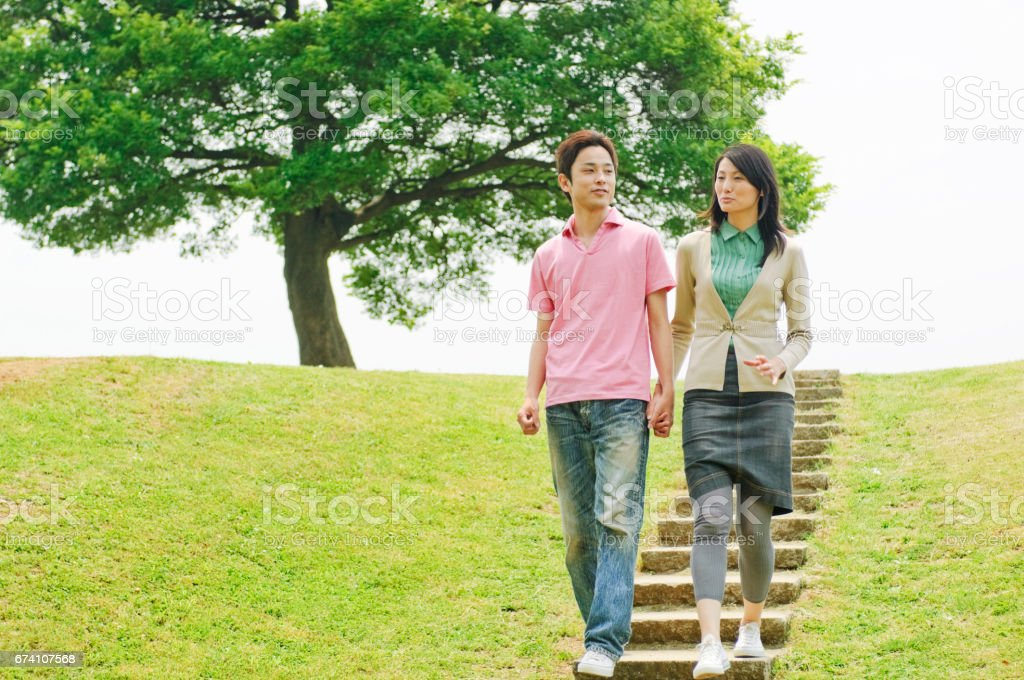 A couple going down the stairs of the Park royalty-free stock photo