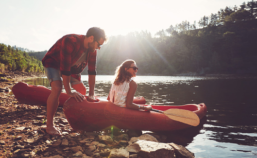 Couple going for kayaking in lake
