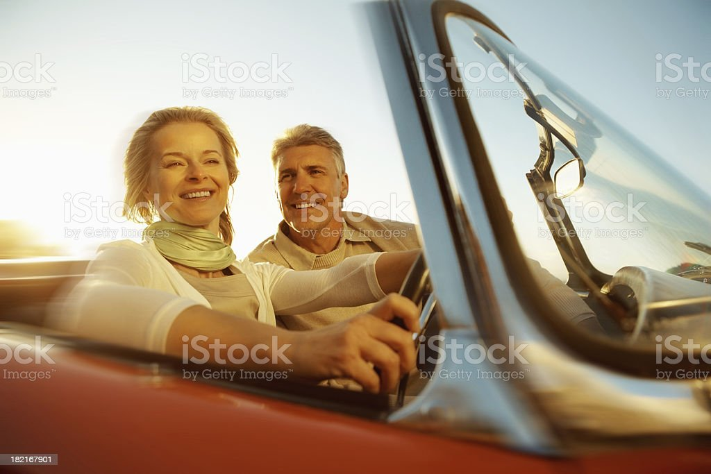 Couple going out for a long drive royalty-free stock photo
