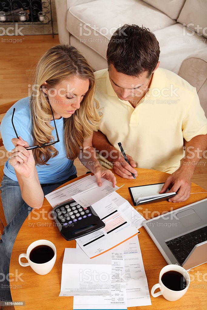 Couple going over their finances with a cup of coffee royalty-free stock photo