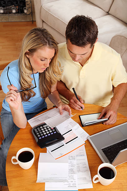 Couple going over their finances with a cup of coffee stock photo
