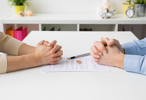 istock Couple going through divorce signing papers 844027168
