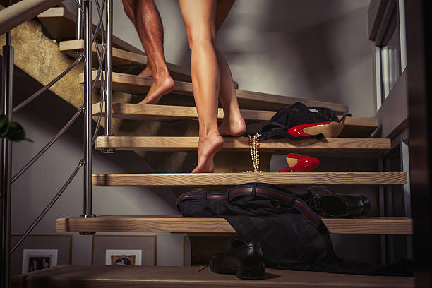 couple going upstairs to the bedroom - gute nacht liebe stock-fotos und bilder
