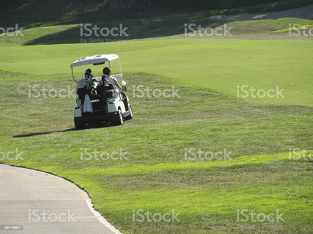 couple golfing royalty-free stock photo