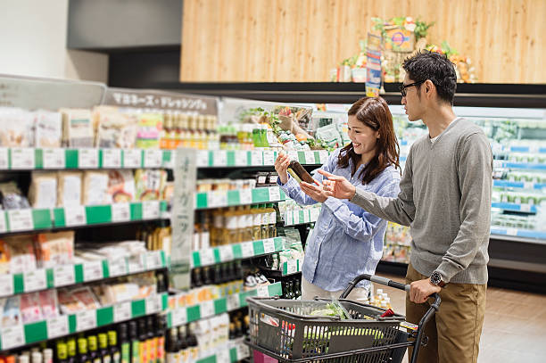 couple grocery shopping at the food market - happy person buy appliances stock photos and pictures