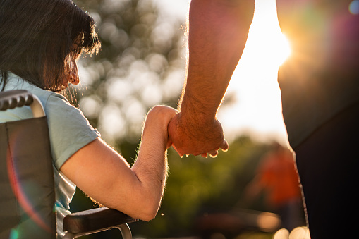 istock Couple hands during sunset 1053564580