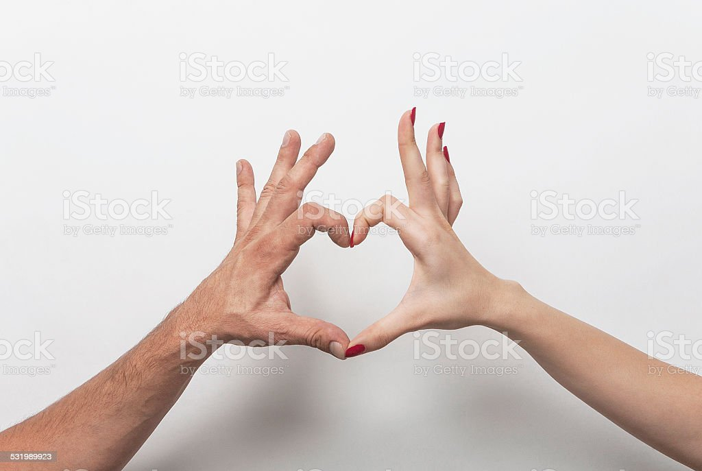 Couple hands making heart gesture stock photo