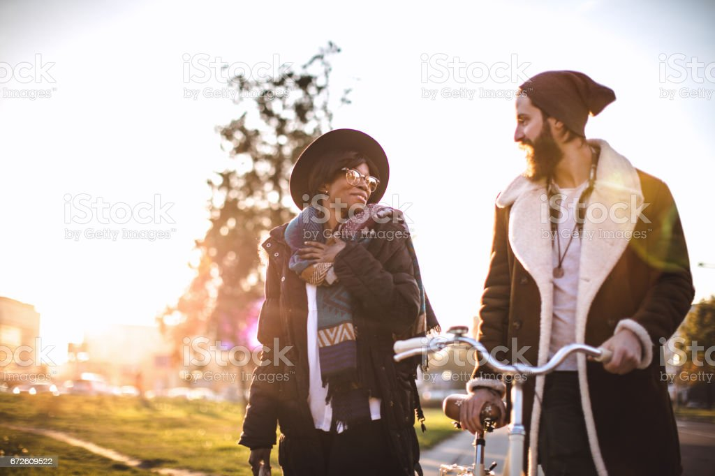 Couple with bicycle in park