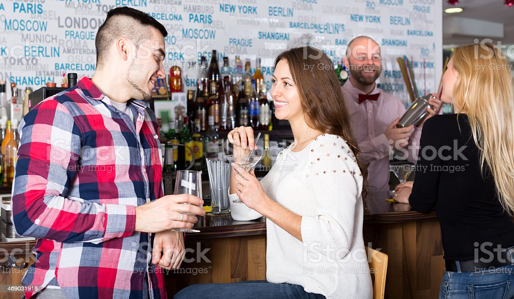 Couple hanging out in bar stock photo