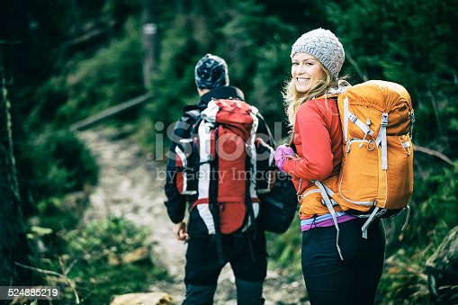 istock Couple happy hikers walking in mountains 524885219