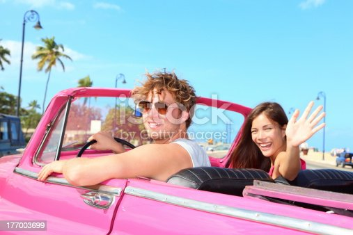 503545320istockphoto Couple happy in vintage retro car 177003699